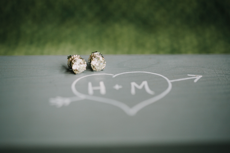 large diamond earrings worn on wedding day