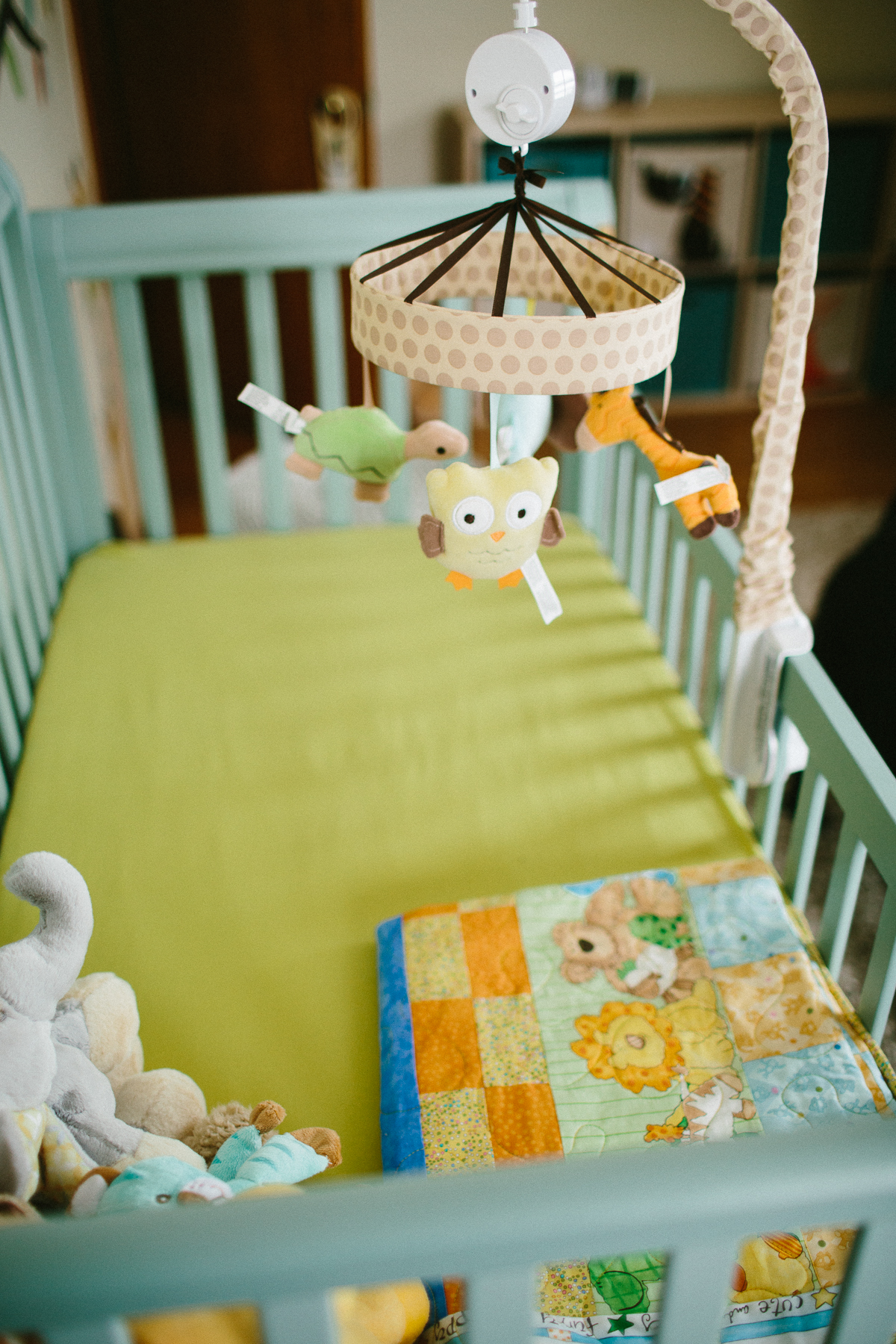 newborn nursery with mobile