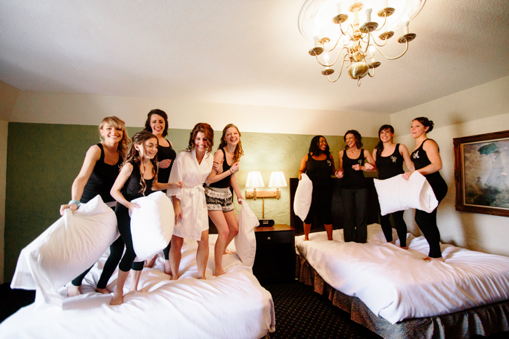 Silly Bridesmaid Photo jumping on a bed in a hotel