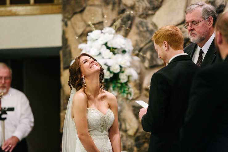 Bride laughing during her vows