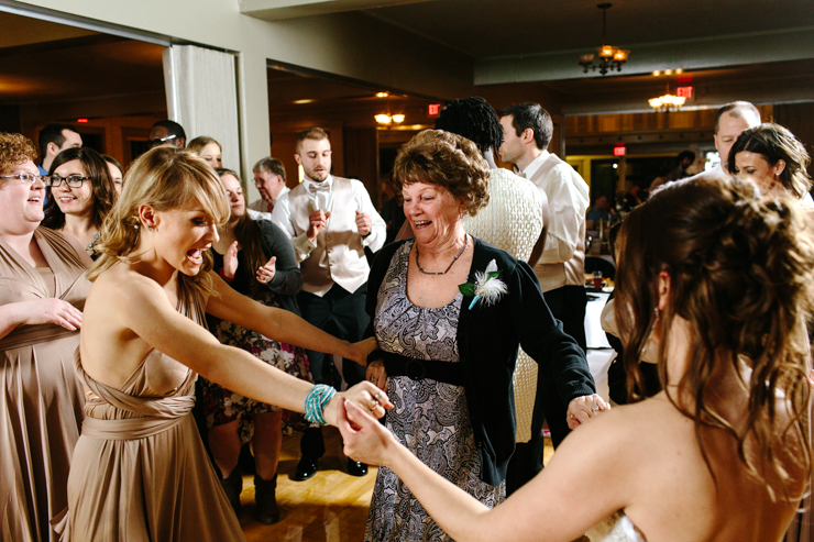 bride danging with her grandma at her wedding reception