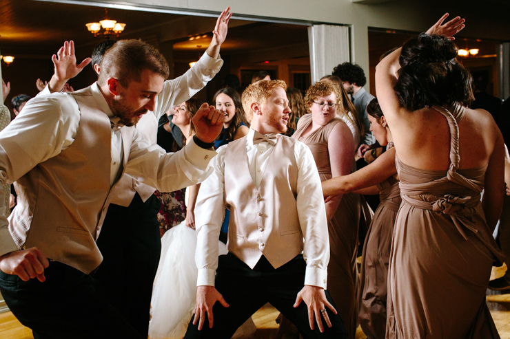 Groom dancing with crazy dance moves at the reception