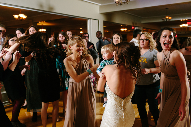 bride dancing with a baby at the reception