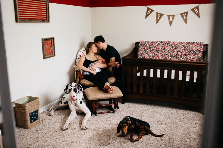 Family in Baby's Nursery with Dogs