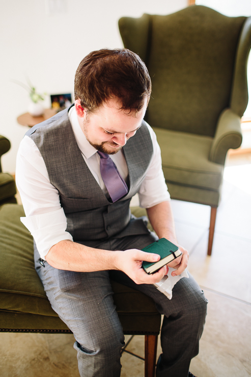 Groom reading a gift from his bride