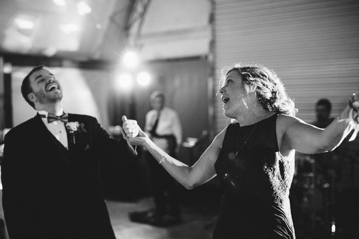 Son and his mother dancing at wedding