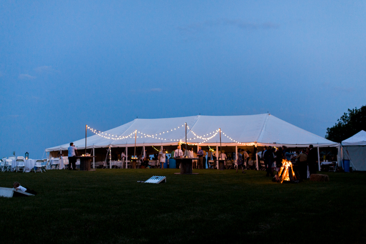 outdoor countryside wedding reception in a big white tent
