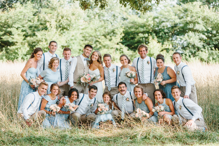 Bridal Party wearing tan and blue outdoor in field at the farm
