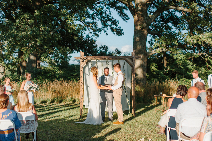 Outdoor ceremony at grandparents' farm at sunset