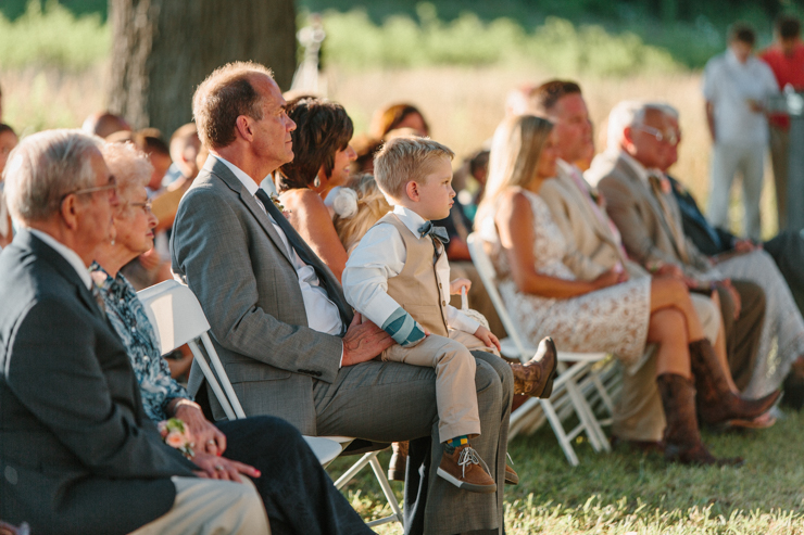 Families watching wedding ceremony of daughter and son