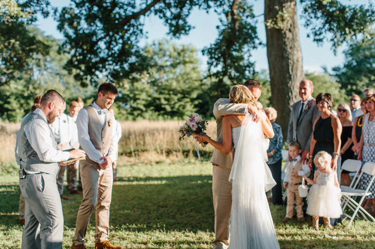 Father giving bride away at wedding ceremony outdoor at grandparents' farm