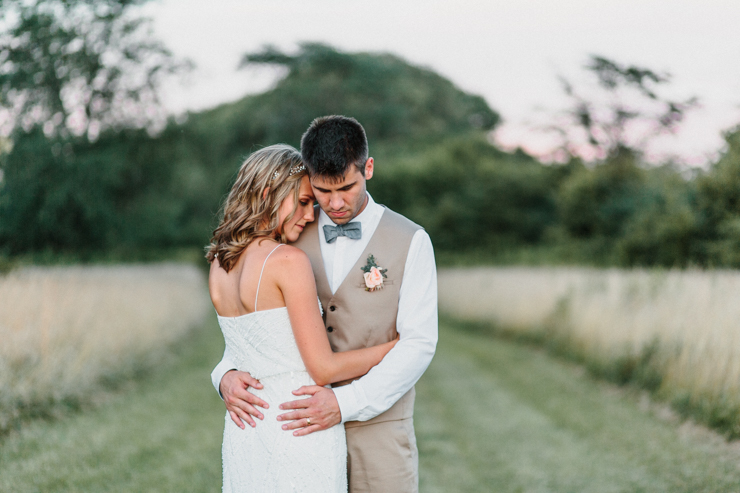 Bride wearing BHLDN Wedding Gown and Groom wearing tan suit intimate wedding portraits