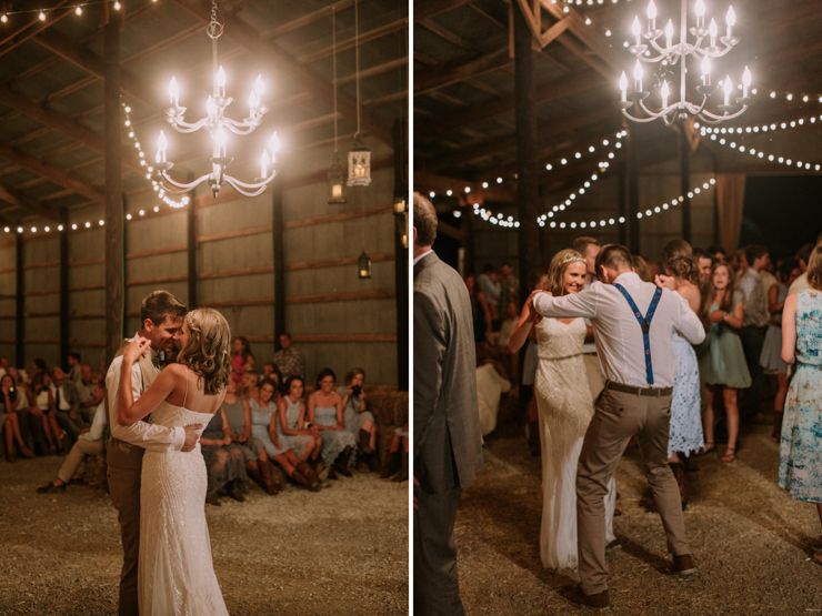 Bride and Groom dancing under edison bulbs and chandeliers in a beautifully decorated barn