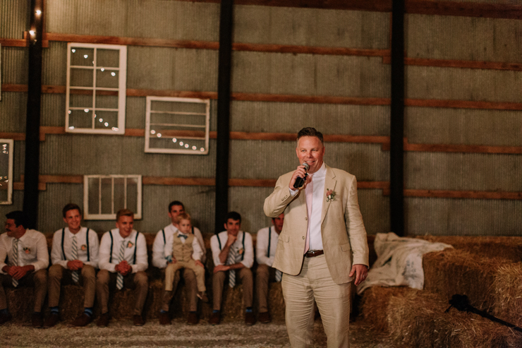 Father giving toast at stunning midwest barn reception