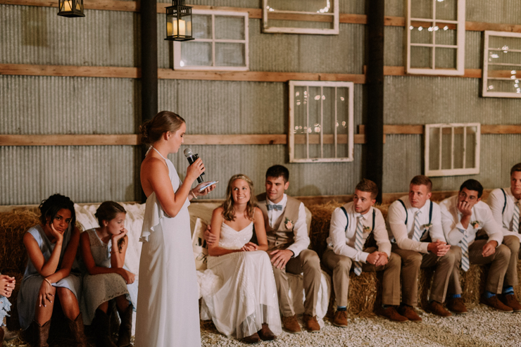 Sister giving toast at stunning midwest barn reception