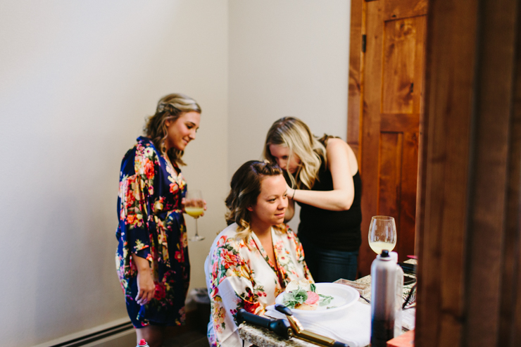 Bride in floral robes getting ready for her wedding day