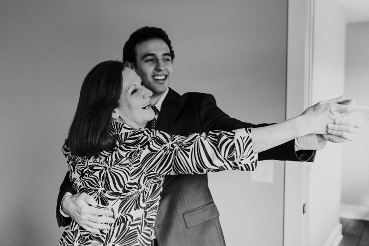 Mother and Son dancing in the getting ready room before wedding