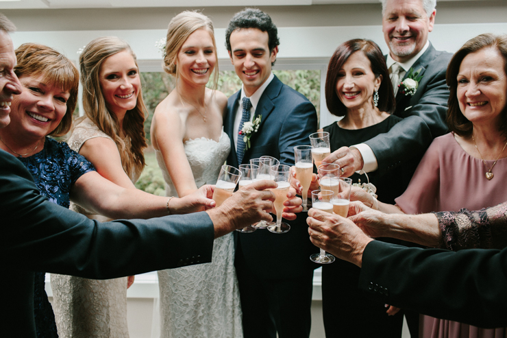 Bride and Groom family toast prior to wedding ceremony Pear Tree Estate Champaign, IL