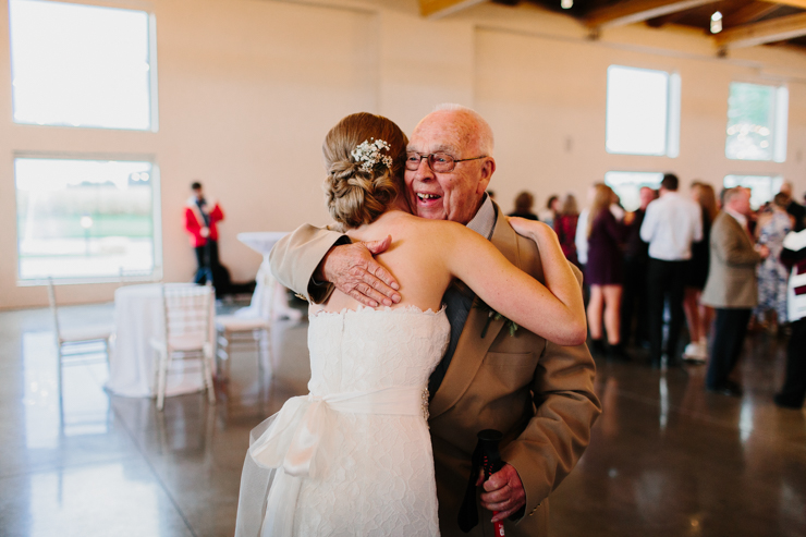 Bride hugging grandpa at wedding reception Pear Tree Estate Champaign, IL