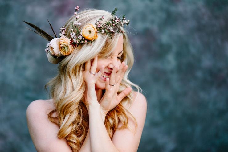 Girl wearing flower crown laughing