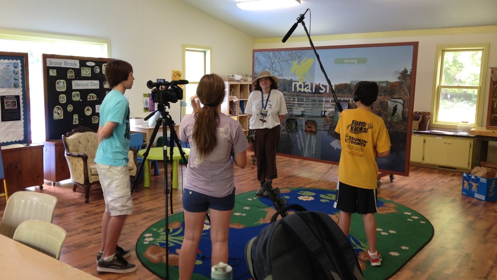Students interview Marla Cohen on location at Stony Brook Wildlife Sanctuary.