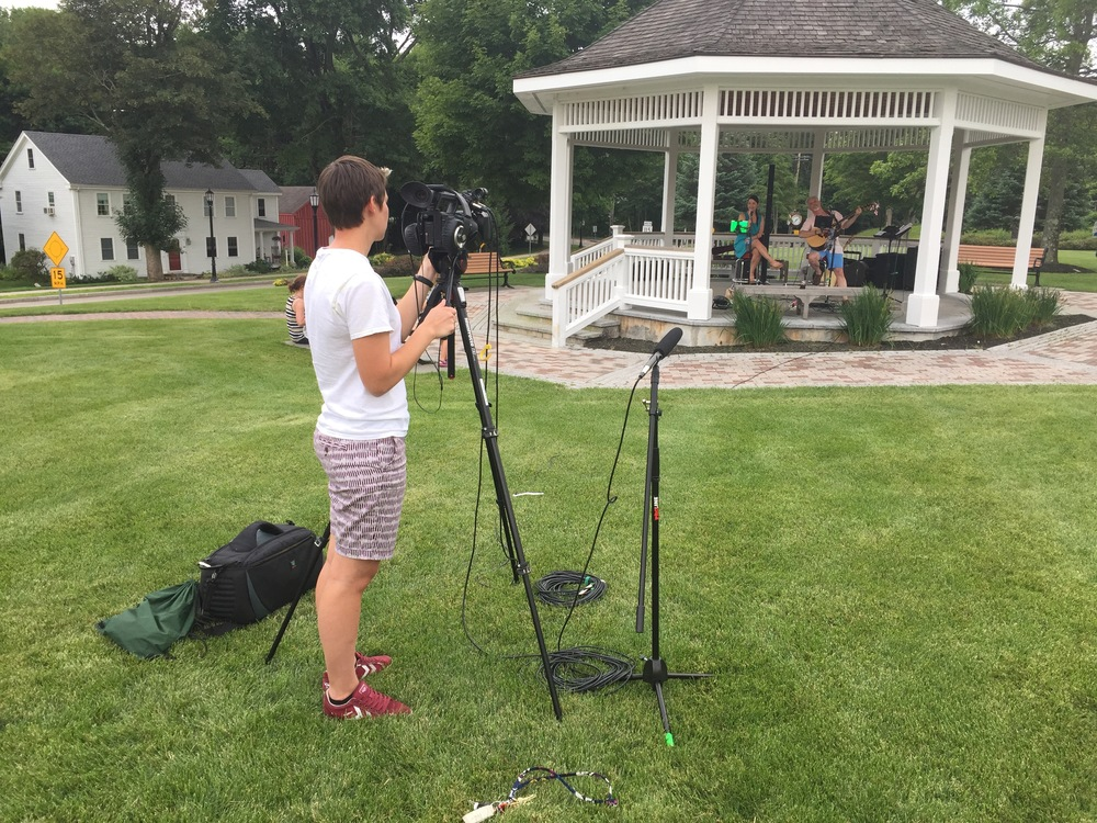 Amelia filming the first concert in this summer's series, The Bill McGoldrick Acoustic Duo feat Danielle Jean.