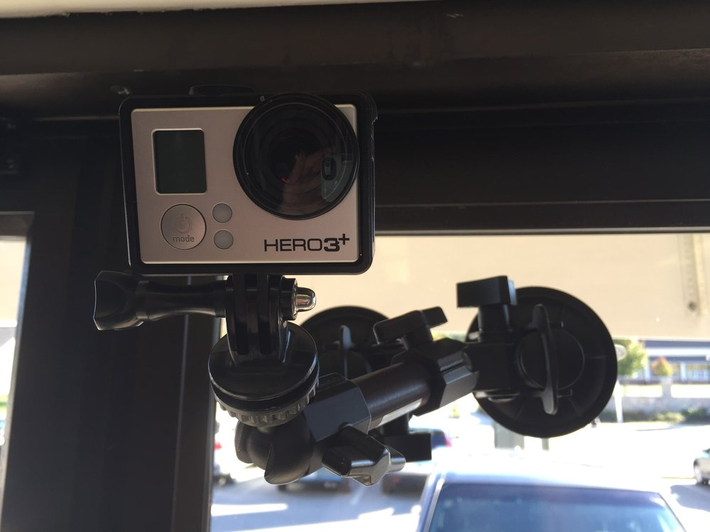 We have a suction cup mount that we use to secure our GoPro to glass.