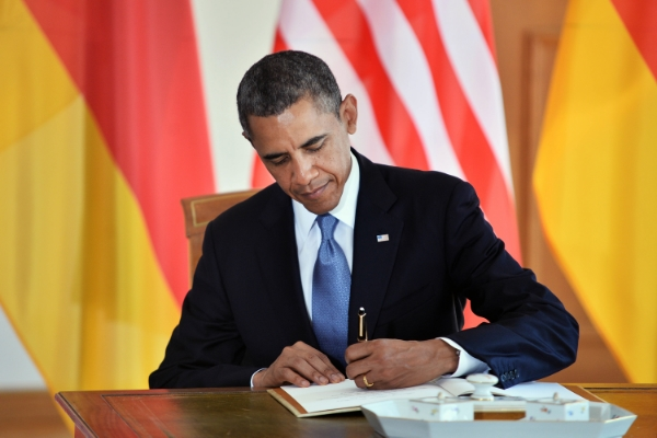 U.S. President Barack Obama and German Chancellor Angela Merkel signing the Golden Book of the city of Baden Baden in the City Hall upon Obama's arrival for bilateral talks on April 3, 2009 in Baden Baden, Germany.