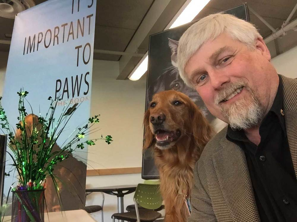 David and Layla at a book signing event - It's Important to Paws