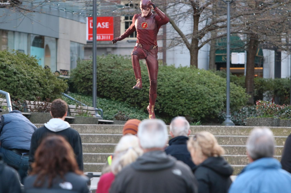 Flash chases after the villains at Lot19! Photo from Vancity Buzz