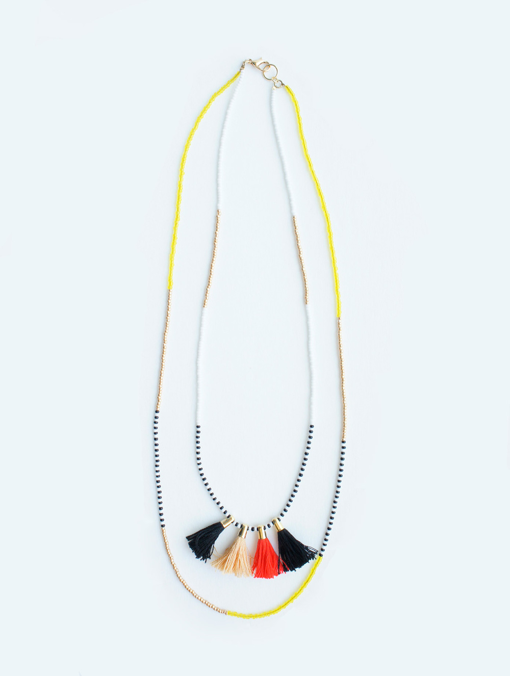 Red tassel charm double layered necklace