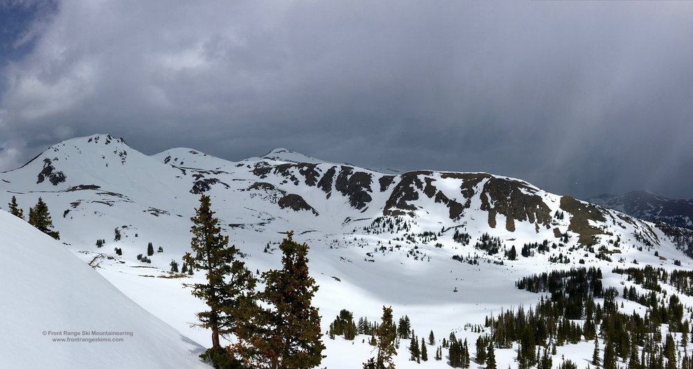 The view of Clark Peak and Sawmill Creek 12,390' from the south. The approach route describes approaching across the base of this photo and then up the snow slope between the two mountains.