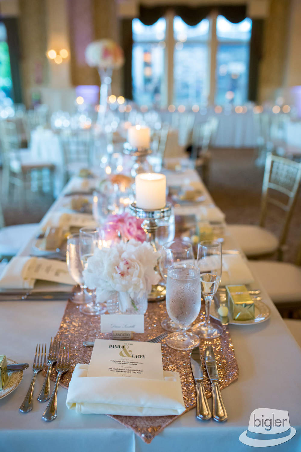 Blush sequined runners worked beautifully for the low tablescape. They glistened against the different mercury candles holders and pebble vases. Lots of textures and of course ... beautiful flowers!