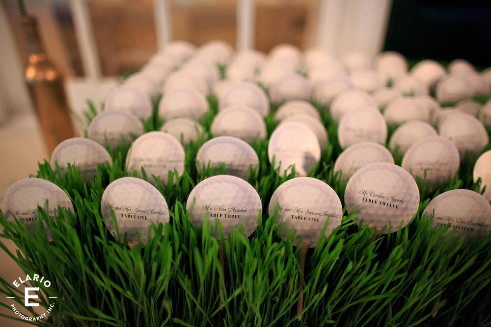Fresh wheatgrass trays holding custom printed table numbers - perfect for this wedding!