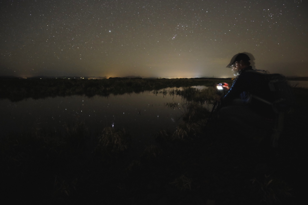 Double Superstars: Dan Bailey shooting the stars reflecting off water with his Fuji X-T1. Shot with my X-T1.