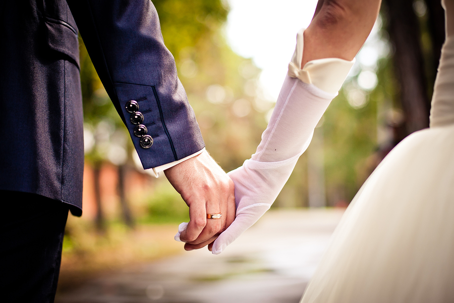 bigstock-Bride-and-groom-holding-hands-44629663.jpg