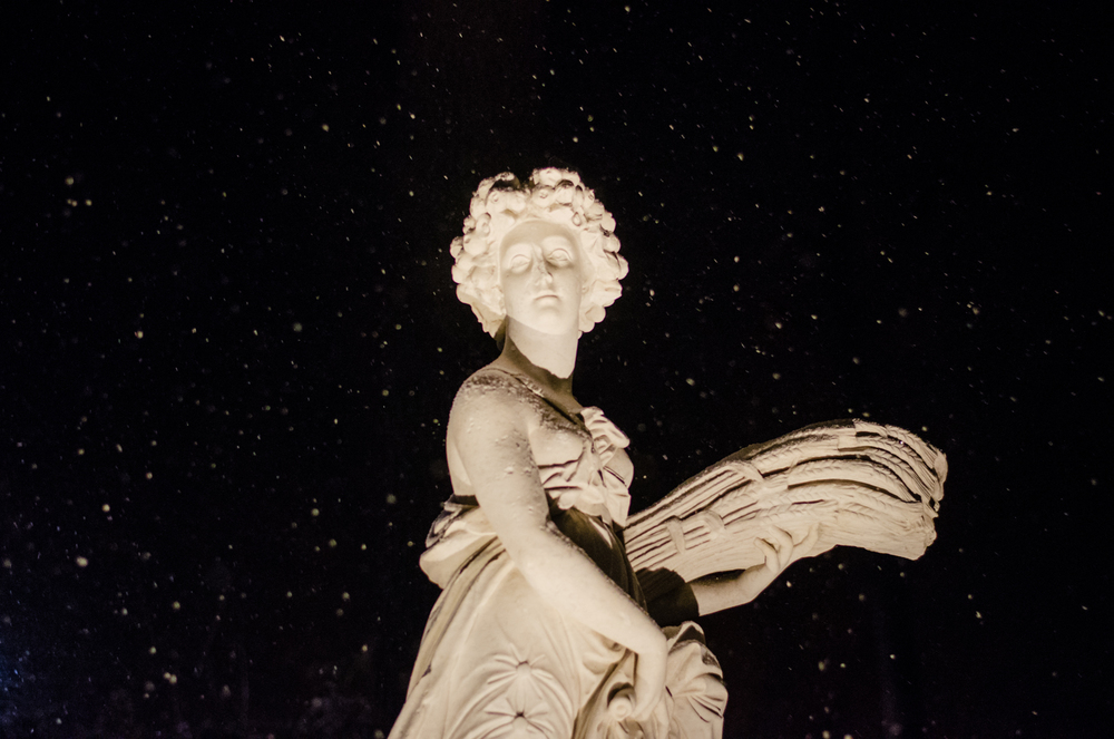 As I was leaving the party, I just had to grab the camera again to capture this shot of snow falling on the sculptures outside Bendel Mansion in Stamford, CT.