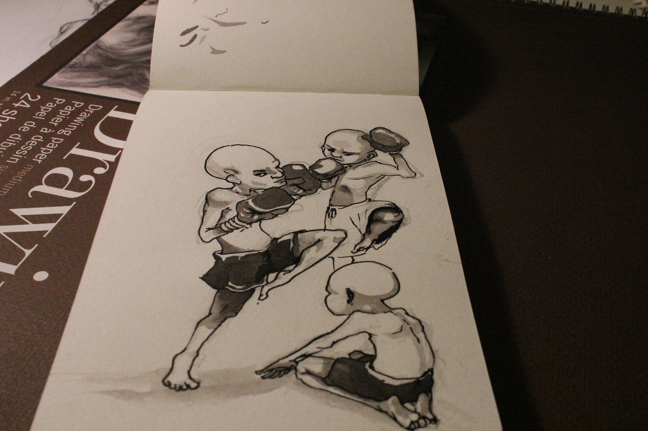 A quick doodle of little big headed kids doing muay thai. No idea why I drew it, except for warm up sketching.