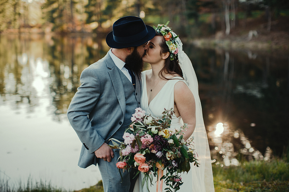 Bride and Groom share a kiss at Camp Kanuga in Hendersonville, NC.