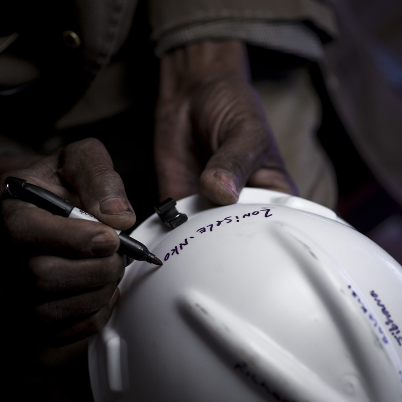 Zonisele signs the miners helmet, leaving space for all the rest.