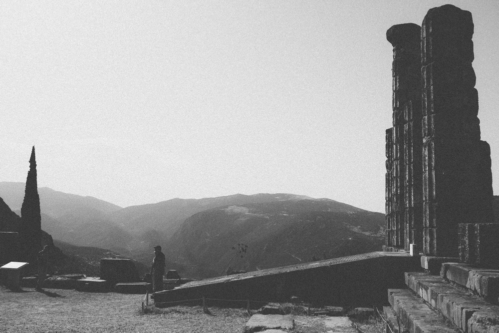 Photo 22. People standing at the entrance of the temple show the scale of ancient greek architecture.  Delphi, Greece, 2014.