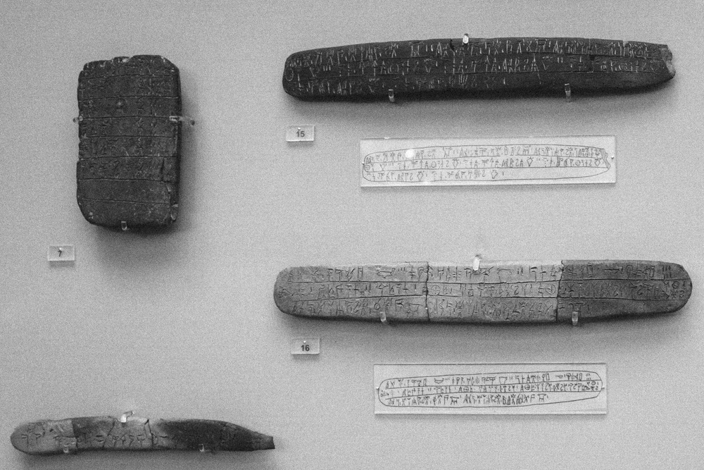 Photo 27. Burned Minoan tablets preserved linear b script - adopted by the Mycenaens for writing their ancient form of the Greek language.  Heraklion Archaeological Museum, Crete, 2014.