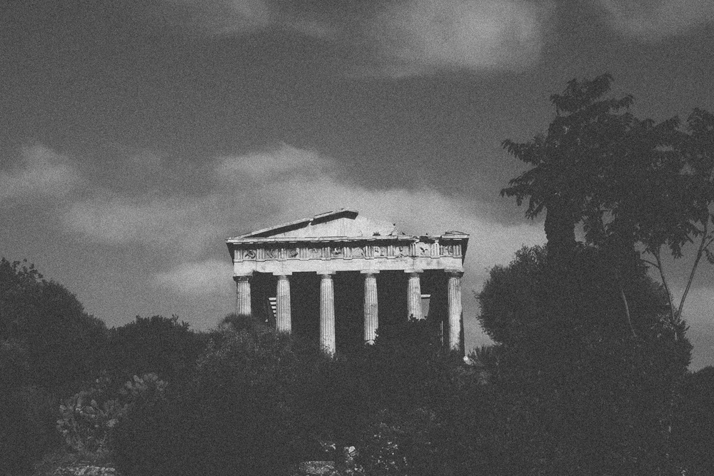 Photo 13. The Temple of Hephaestus in the ancient agora of Athens is built in the Doric style.  The frieze above the columns depicts the Greek Heroes Theseus and Heracles (Hercules).   Athens, Greece, 2014.