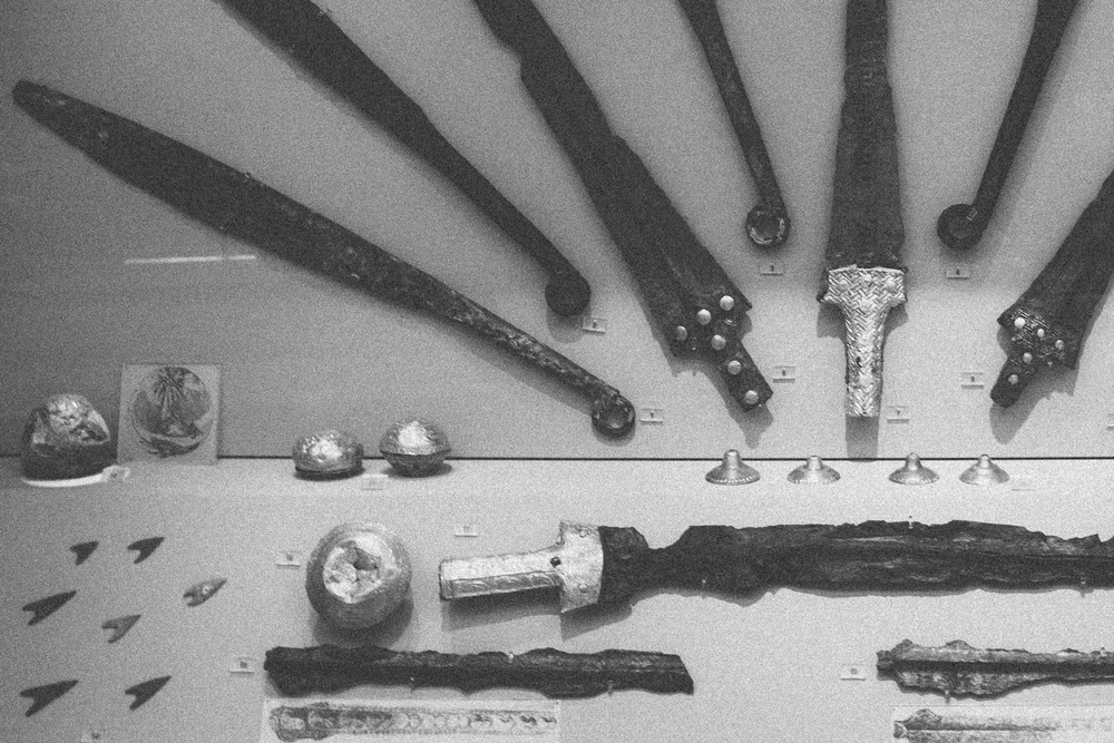 Photo 7.  Several bronze swords from the Mycenaen civilization that was built on conquest and constant wars - artifacts of a warrior aristocracy.   National Archaeological Museum, Athens, 2014.