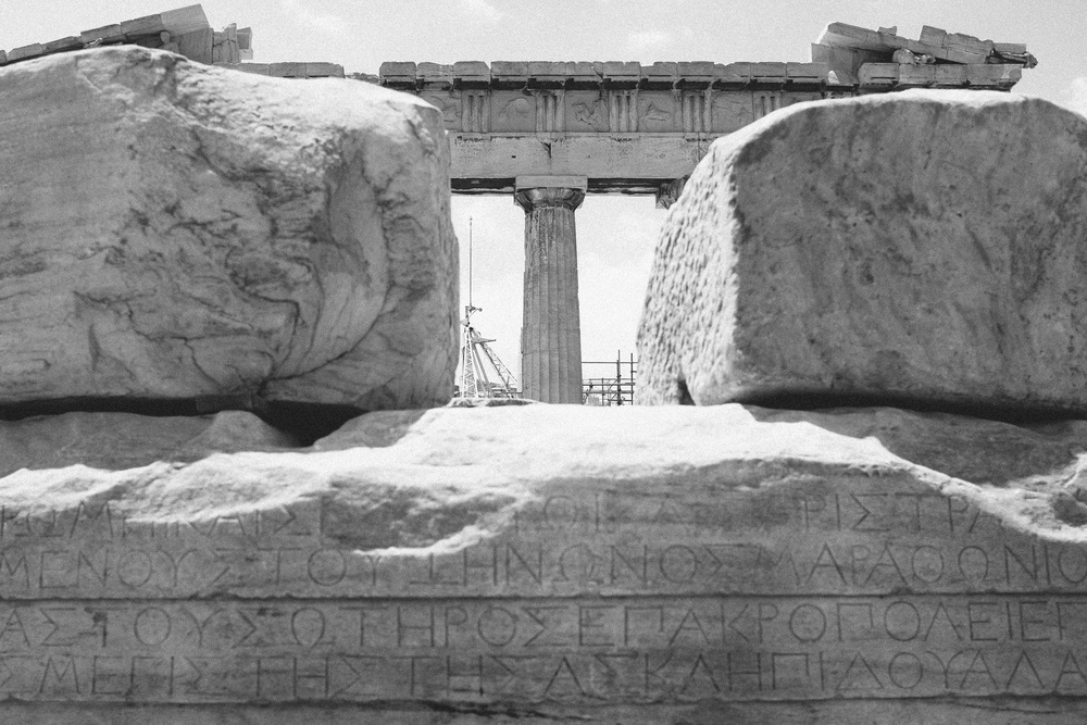Photo 29.  The Greek written alphabet chiseled into marble ruins atop of Acropolis.  The symbols also represent concepts like 'Alpha', and 'Omega' and are used widely in mathematics.  Athens, Greece, 2014.