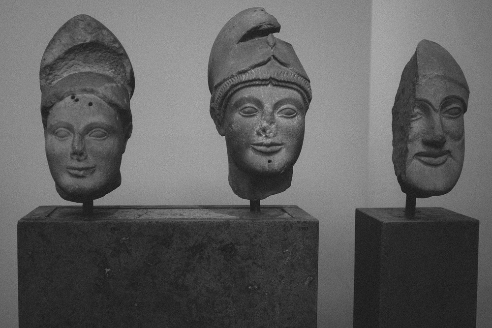 Photo 69.  Sculpture depicting helmuted warrior heads of mythological Greek heroes.  National Archaeological Museum, Greece, 2014.