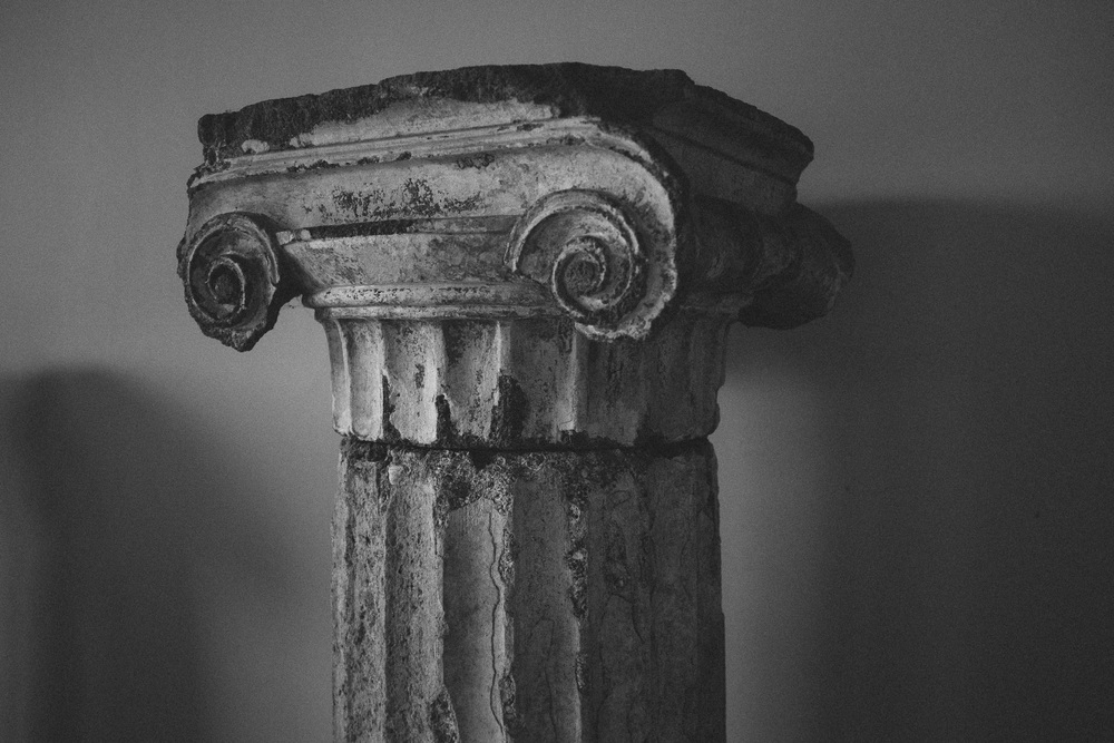 Photo 77. Ionic capital - one of three architectural orders.  Olympia, Greece, 2014.