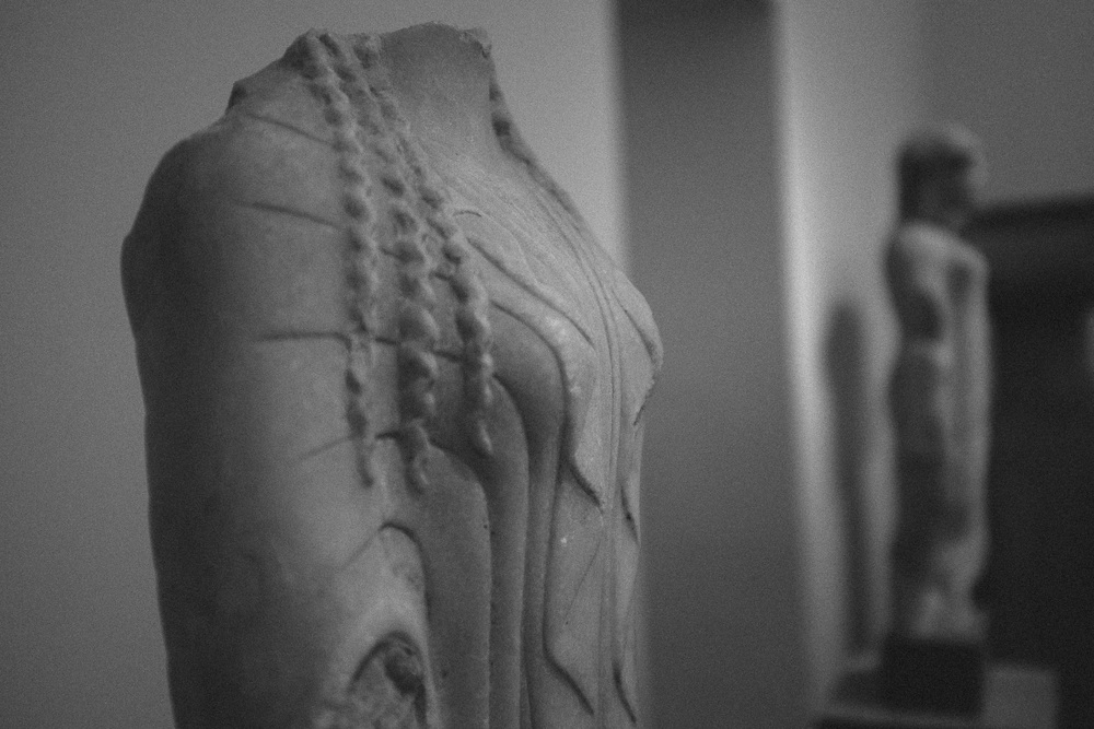 Photo 72.  Marble statue of archaic period Kore.   National Archaeological Museum, Greece 2014.
