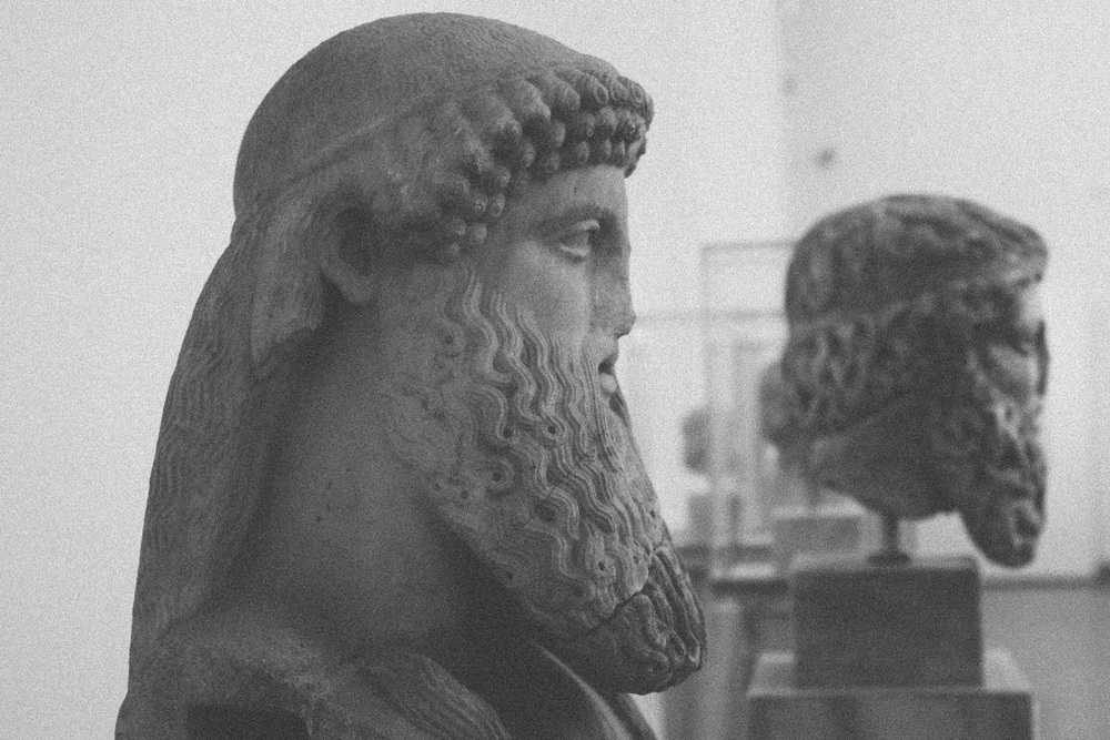 Photo 74. Portraits of bearded men or Gods in marble.  National Archaeological Museum, Greece, 2014.