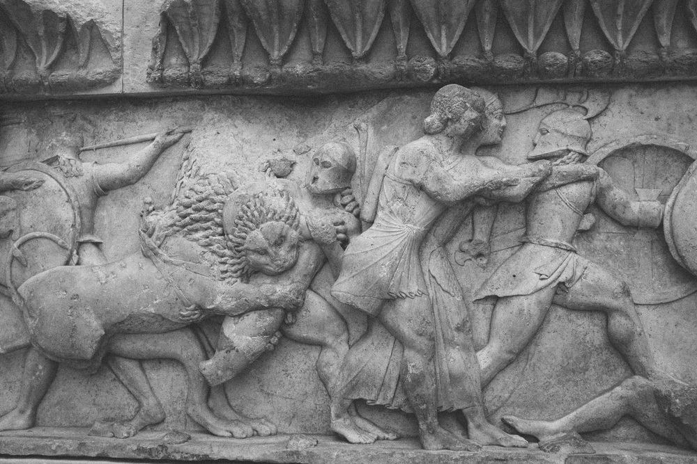 Photo 66. A marble frieze of the Siphian Treasury at the Delphi sanctuary depicting the Olympian Gods in battle with Giants - known as the Gigantomachy.  Delphi, Greece, 2014.